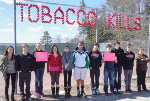 "Students from Mrs. Jill Denniston's and Ms. Judy Earle's advocacy sixth-, seventh- and eighth-grade classes at Philip W. Sugg Middle School in Lisbon Falls participated in the National ""Kick Butts"" Day Campaign on March 20. From left are Hayley Wheeler, Nick Bergeron, Rosalie White, Aarika Hallowell, Morgan Roy, Tyrese Joseph, Anthony Dunigan, Corey Hodgkins, Bryant Hall, Brad Harriman and Devin Wordell."